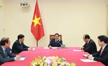 Thủ tướng Lào điện đàm chúc mừng Thủ tướng Phạm Minh Chính